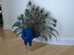 mom & I made this awesome peacock out of a pumpkin!!!! used Aunt D's real feathers!!!! thanks! love it!