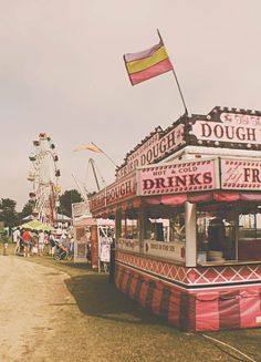 Okay So just a random story about me. I've always dreamed of living in the 1960s and wearing one of the cute dresses with my hair up in a bun and going to a carnival. The carnival I imagine looks almost exactly like this therefore I absolutely adore this pic