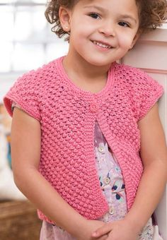 Free Knitting Pattern for Easy 4-Row Repeat Little Girl Shrug -This easy child's cardigan is knit in a 4-row repeat trinity stitch. Sizes 2, 4, 6, 8 years. Designed byCathy Payson for Red Heart