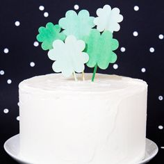 Get ready for St. Patrick's Day and make these festive stained wood clover cake toppers.