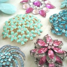 Thinking of collecting a whole bunch of vintage/antique broaches for everyone's bridal shower favor. I'm starting to look around & collect them. We have a year, right? :)
