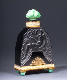 HOFFMAN perfume bottle, circa 1920s, in black and green crystal, with enamelled metal collar, and marcasite trimmed holder, with green crystal feet.