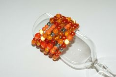 Unique orange memory bracelet made with magic beads acrylic beads m tallic beads rubber beads metal memory wire You just have wrap it around your wrist If you want eargins Aluminum Wire Jewelry, Memory Wire Jewelry, Memory Wire Bracelets, Prom Jewelry, Summer Jewelry, Wedding Jewelry, Gifts For Women, Gifts For Her, Bijoux Fil Aluminium