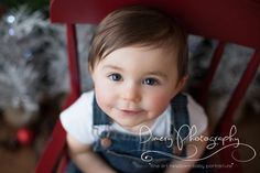 toddler in overalls, holiday portrait, baby in red chair, natural light portrait studio © Dimery Photography 2013