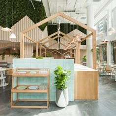 """Dining areas within this Melbourne restaurant are housed beneath individual pitched roofs, which local practice Biasol Design Studio added to give the space a """"home away from home"""" feeling"""