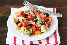 This tortellini salad sounds different in flavor than my salad. The balsamic dressing is the interesting part. Think I will add a few things to the shopping list and make this one this weekend. - Pam