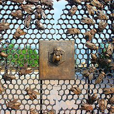 Sculptor Christopher Russell's bee gate at the 9th Avenue Station, Sunset Park, Brooklyn