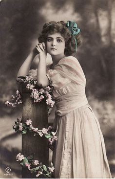 1910s...Beautiful Edwardian Lady...Hair Bow...Flowers....Fence Post...original vintage french postcard