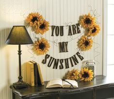 String together a cheerful wall garland that combines annealed wire, painted wood letters faux sunflowers. This project originally appeared in Country Sampler Autumn Decorating Western Wall Decor, Family Wall Decor, Cute Wall Decor, Country Wall Decor, Office Wall Decor, Unique Wall Decor, Metal Wall Decor, Sunflower Room, Sunflower Wall Decor