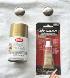 Rub N' Buff is a waxy metallic finish that comes in several golden shades such as Gold Leaf (depicted), but also look for Antique Gold and European Gold.  Krylon's 'Gold Leaf' is the best metallic gold spray paint I've found to date to mimic brass or give you a warm golden glow on your hardware.