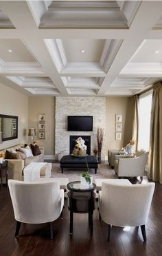 #homedesign #livingroomdecor #inspiration | This is an example of a traditional enclosed living room in Toronto with a stone fireplace surround, a standard fireplace and a wall-mounted tv. — Houzz