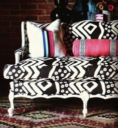 I have a crush on black & white Ikat, and victorian love seats. . . put together, this is my dream love seat.  Decorate With Mudcloth