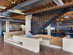 Heavybit Industries / IwamotoScott Architecture / To spatially subdivide the first floor and create different areas on each side, while keeping it visually open, the platform also serves as the first landing for the new stair to the second floor.