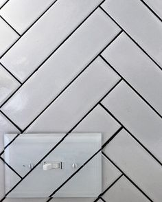The rest of the backsplash is white tiling that was cleverly placed into a herringbone pattern. Kristin says 350 tiles were used, with 191 cuts made!
