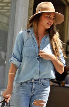 Button up: Shortly after, Teigen covered up by buttoning her shirt a little higher...