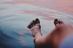 Summer, putting my feet in the lake. It's one of the first things I do when I go to my cottage in Maine.