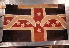 "1st Tennessee Infantry. In late 1862 the 1st received a new flag, which follows the Polk Corps pattern flag. However, it was modified, the cross is edged with gold. Even more unusual are two ""waves"" The left wave probably had the battle honors ""Perryville"" and the right may have had that of ""Shiloh"". At the bottom are faint crossed cannons which was a battle honor used by Maney's Brigade after the Battle of Perryville for the capture of Parson's 4th U.S. Artillery Battery."