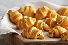 Cream Cheese Bacon Crescents -  1 tub (8 oz.) PHILADELPHIA Chive & Onion Cream Cheese Spread on surface of rolls,  3 slices cooked OSCAR MAYER Bacon, crumbled over the cream cheese. Roll up and bake. CS