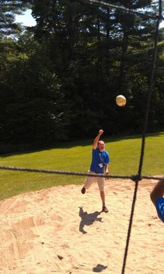 French teachers get into the volleyball game at Lake Dunmore, Vermont
