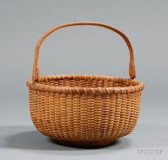 "Nantucket Basket, 9 3/4"" diameter with oak swing handle."