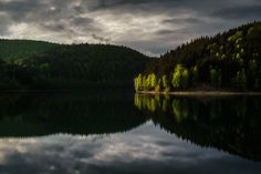 Talsperre Schonbrunn - Sunbeams illuminating trees along the shores of the basin created by the Schoenbrunn dam.