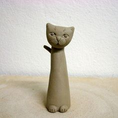 how to make a cat with regular clay - nice tute in Slovenian. Good pictures. No reason not do do a herd of these in Polymer Clay. #polymer #clay #tutorial