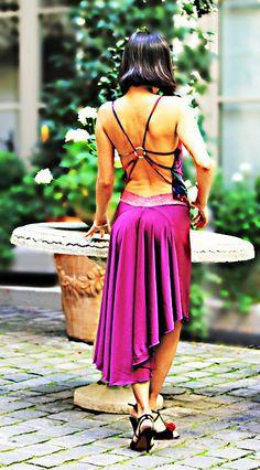Interesting open back top, flowy high low skirt.