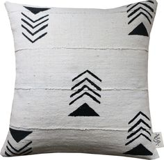 """Kilima means """"mountain"""" in Swahili. Designed and handpainted in Brooklyn, NY on natural imported mudcloth from Mali, the Kilima pillow is inspired by the mountain tops of East Africa'..."""