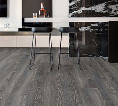 Amor Laminate flooring in colour Highland Oak Black.  It is easily the most realistic timber look in the laminate range and an 'embossed in register' grain authentically replicates the appearance and texture of timber.