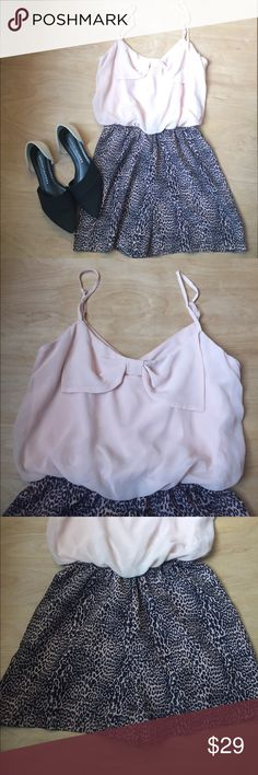 Leopard Print Romper Adorable pink and leopard print Romper. Size Small with adjustable straps. Cute bow detail on the top and leopard print bottoms. Gently worn and in great condition! Please let me know if you have any questions and feel free to make an offer! Accidentally In Love Other