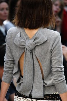 lovely open back bow sweater