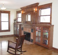 Craftsman fireplace with built-ins on either side of it.