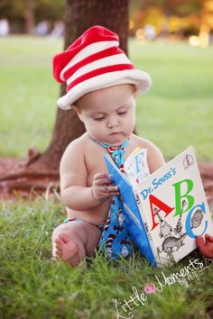 Little moments photography.  algphotography3@gmail.com Colin has FPIES so he could not have a cake smash for his first birthday. Instead we did a present opening :) Dr. Seuss cat in the hat.
