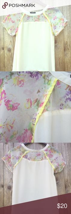 Floral hi-lo blouse Floral hi-li style top with sheer neckline and sleeves. This is a cream color top. Size small but can fit up to a medium. Does not stretch and not recommended if you have a large chest. Verty Tops Blouses