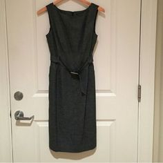 Banana Republic Gray Dress Dark Gray strapless dress with belt from banana republic. The sides have pockets that are still sewn together. A small slit in back. Brand new with tags! I bought off here but my hips are too big to fit in dress.... Dresses Strapless