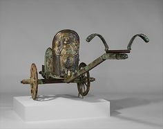 In 1902, a landowner working on his property accidentally discovered a subterranean built tomb covered by a tumulus (mound). His investigations revealed the remains of an Etruscan parade chariot as well as bronze, ceramic, and iron utensils together with other grave goods. The Metropolitan Art Museum