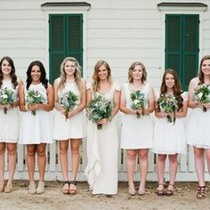 Unique wedding atop a parking garage - and we love these maids in white!