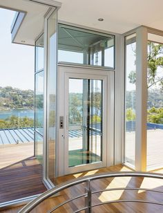 Exterior glass lift or elevator is a nice way to get down to the pool area - Ascenseur de maison individuelle ...