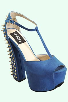 This breathtaking peep toe  sandal is sure to keep all eyes on you! Features a chunky spiked heel.