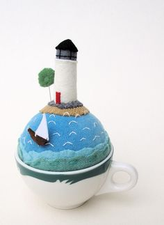 tiny world with lighthouse