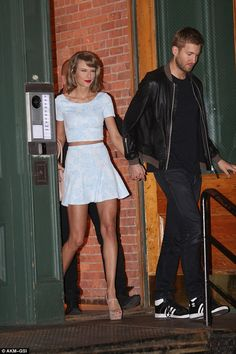 All smiles: The Blank Space singer looked like the cat who got the cream as she left a building in NYC with Calvin