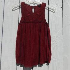 American eagle halter top Super cute maroon halter tank. Never worn. No tags but brand new. It says XS but can fit XXS-S. Lower on Mercari American Eagle Outfitters Tops Tank Tops