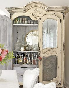 shabby chic armoire repurposed as a bar