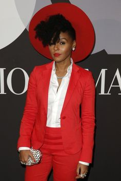 Janelle Monae carrying an Edie Parker clutch. [Photo by Joe Scarnici/Getty Images for GQ]