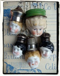 "Danni Townsend O'Neil creates these quirky hand crafted pendants from antique ""Frozen Charlotte"" dolls that she rescued from a demolition site in Russia."
