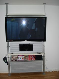 cool way to hang a flat-screen tv without holes in your walls