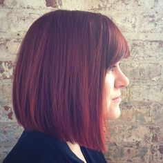 Blunt lob for thick hair,  nice slight fall from rear to front, not extreme, plus shows w bangs