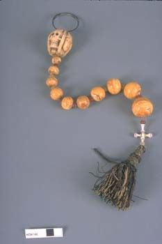 Rosary (single decade).  16th/17th century.  Flemish.  Ivory, textile.  Limerick: The Hunt Museum.