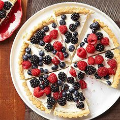 Highlight seasonal berries in a patriotic sugar cookie tart. Fat-free cream cheese and Greek yogurt keep the frosting layer light.