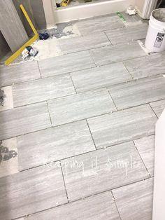 How to Tile a Bathroom Floor With 12x24 Gray Tiles